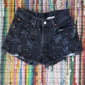 Distressed black denim shorts, size 27